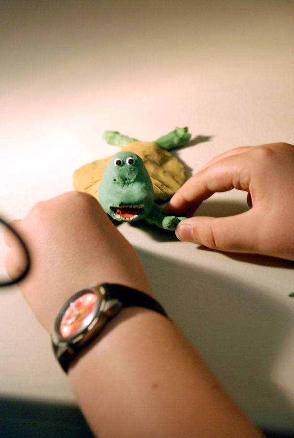 young person modelling a tortoise ready for animation
