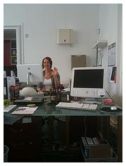 Kathryn B sat her desk, waving