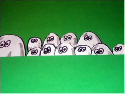 a picture from the interact project showing white cartoon characters bunched up together with big eyes looking out at the viewer.