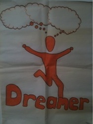A picture of a red figure with the word 'dreamer' underneath him
