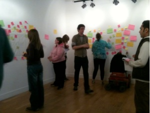 Young artists sticking post-it notes to the wall